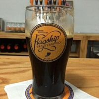 Photo taken at Flagship Brewing Co. by Miguel R. on 6/10/2014