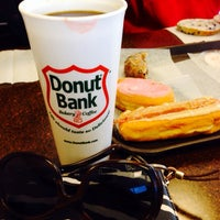 Photo taken at Donut Bank Bakery & Coffee Shop by Sherry W. on 5/19/2014