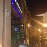 Photo taken at Smallworld Cafe by Ekaterina K. on 10/8/2012