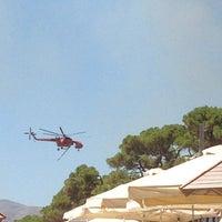Photo taken at Παραλία Δελφίνι by Tasos P. on 8/5/2013