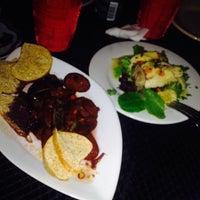 Photo taken at Pura Vida Food & Fun by Val on 4/19/2014