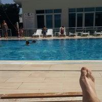 Photo taken at Ay Işığı Havuz Başı by Kürşat K. on 8/27/2014