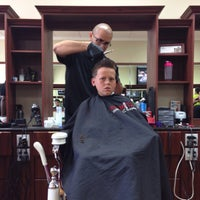 Photo taken at Ultimate Barbers by Jeffrey M. on 4/12/2014