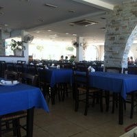 Photo taken at Zephyros Fish Tavern by Alessandro T. on 6/25/2014
