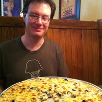 Photo taken at Hometown Pizza by Georgina T. on 7/14/2013