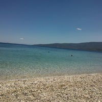 Photo taken at Kalamaki Beach Hotel Beach by Antonis E. on 7/13/2014
