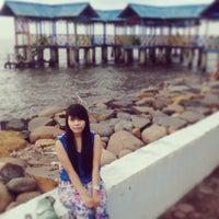 Photo taken at Pantai Pasir Kencana by Ariis T. on 3/3/2014