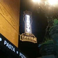 Photo taken at Henry's 12th Street Tavern by Bryan B. on 12/8/2012