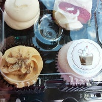 Photo taken at Flavor Cupcakery by Corinna J. on 5/17/2014