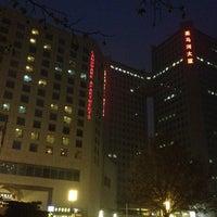 Photo taken at 亮马河大厦 by Peng Z. on 12/15/2012