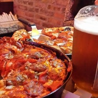 Photo taken at Pequod's Pizzeria by Patrick S. on 11/3/2013