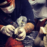 Photo taken at Conviction Tattoo by Rodolfo A. on 3/5/2013