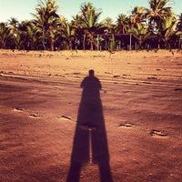 Photo taken at Praia de Taipus de Fora by Carlo C. on 5/17/2013