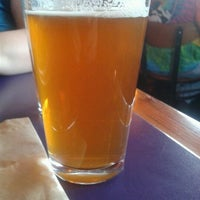 Photo taken at Moose's Tooth Pub & Pizzeria by Jim C. on 7/2/2012