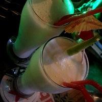Photo taken at Tiki bar by Yeraldín A. on 8/22/2014