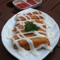 Photo taken at Coklat Cafe by Eny S. on 10/11/2012