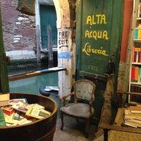 Photo taken at Libreria Acqua Alta by Kaitlin T. on 4/4/2015