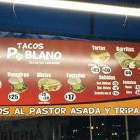 Photo taken at Tacos El Poblano by Marlon C. on 12/23/2013