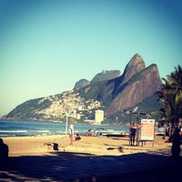 Photo taken at Ipanema Beach by Daniel H. on 5/12/2013