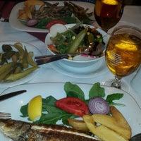 Photo taken at Sembol Fısh & Meat House by Gülşah K. on 8/30/2014