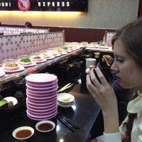 Photo taken at Sushi Express (争鲜回转寿司) by Denis L. on 1/3/2015