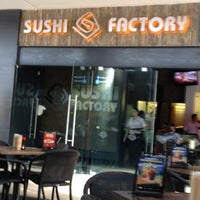 Photo taken at Sushi Factory by Carlos C. on 11/15/2012