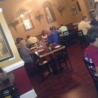 Photo taken at Delucca's Italian Grill by Karen T. on 8/9/2014