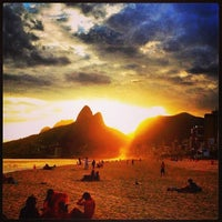 Photo taken at Ipanema Beach by Bianca R. on 5/26/2013