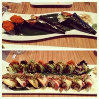 Photo taken at Pinto Thai Bistro & Sushi Bar by Michelle Y. on 8/23/2013