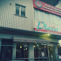 Photo taken at Planet Cafe by Hüseyin Ş. on 5/21/2015