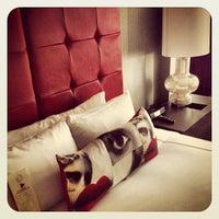 Photo taken at Kimpton Hotel Rouge by Mac P. on 3/26/2013