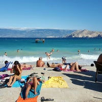 Photo taken at Baška Beach by Vadim I. on 7/31/2015