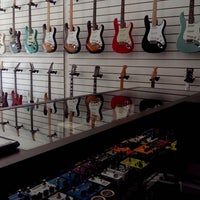 Photo taken at Jeff Guitar Shop by Andrew Martinelle M. on 11/21/2013