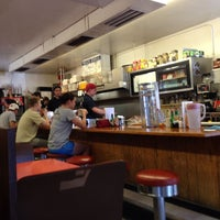 Photo taken at Village Coffee Shop by DV G. on 6/14/2014