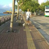 Photo taken at Belcher Bay Park / Kennedy Town Praya Bus Stop 卑路乍灣公園/堅尼地城海旁巴士站 by Kangie A. on 6/2/2016