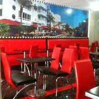 Photo taken at American Café & Grill by Mounir D. on 11/13/2013