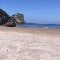Photo taken at Playa de Ballota by Chuli on 8/2/2017
