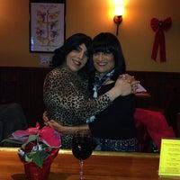 Photo taken at Espana Tapas Wine Bar by Debrah S. on 12/16/2013