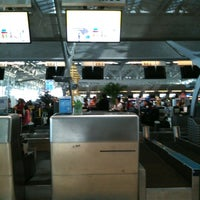 Photo taken at Malaysia Airlines (MH) Check-In Area by 🌴Bev T. on 10/27/2012