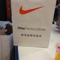 Photo taken at Nike factory store by Evaristo D. on 7/14/2013