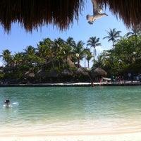 Photo taken at Playa Xcaret by Lilian Paula V. on 3/31/2013