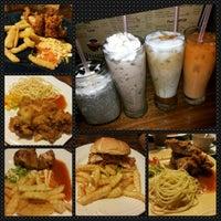 Photo taken at Giggle Box Cafe & Resto by Yohanna C. on 3/6/2014
