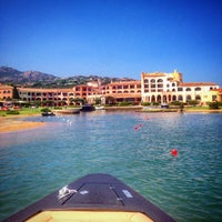 Photo taken at Cala di Volpe by Akim H. on 8/12/2015