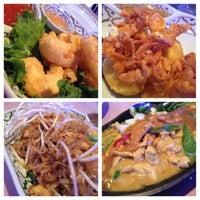 Photo taken at Bangkok Cuisine by julie Ü. on 3/18/2014