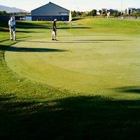 Photo taken at Mulligans Golf & Games by Sarah G. on 9/5/2012