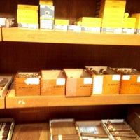 Photo taken at JJ Fox & Robert Lewis Cigars by Sonali F. on 12/23/2013