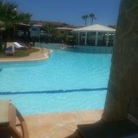 Photo taken at Atlantica Aeneas Resort Hotel pool by Serge D. on 7/17/2014
