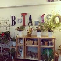 Photo taken at Café Botánico by Vanessa C. on 3/24/2013