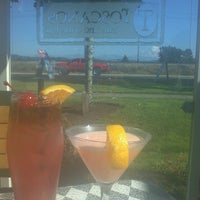 Photo taken at Toscanos Cafe & Wine Bar by Shellie P. on 8/31/2013