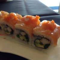 Photo taken at blue sushi by Irene N. on 9/12/2014